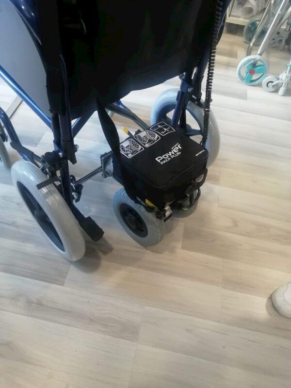 Motor eléctrico para adaptar en sillas de ruedas manuales